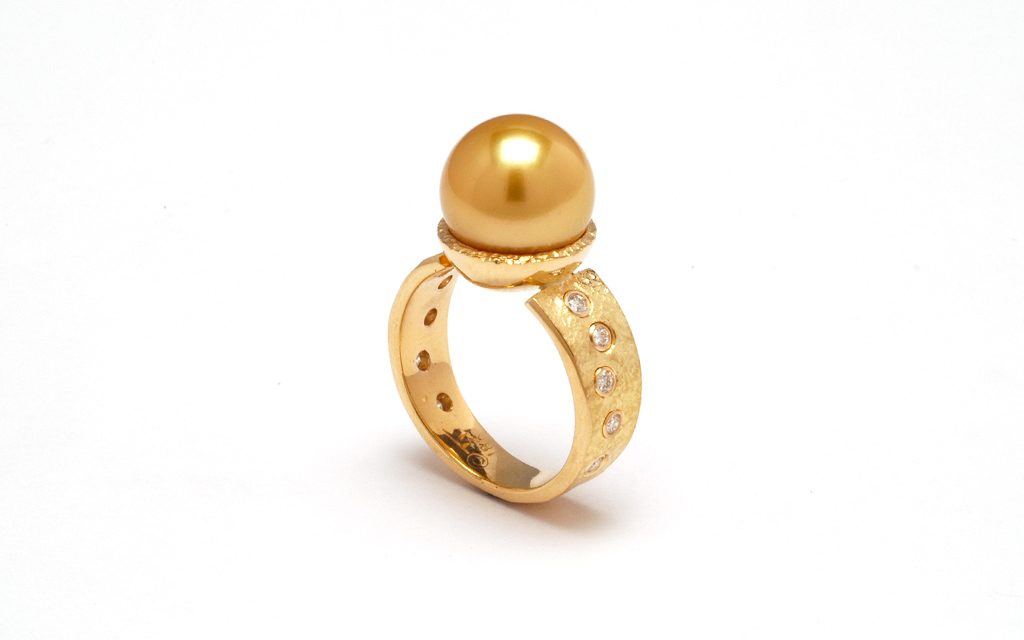 8009R - 18 karat gold ring set with an incredible 12mm natural golden South Sea Pearl accented with .20cttw. Diamonds (8.6g) Price Upon Request