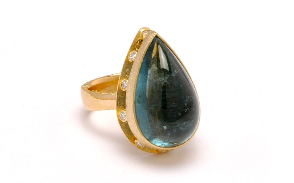 8010R - 18 karat gold ring set with a 21.03 carat green blue Tourmaline Cabochon and .20cttw. Diamonds (9.9g) Price Upon Request