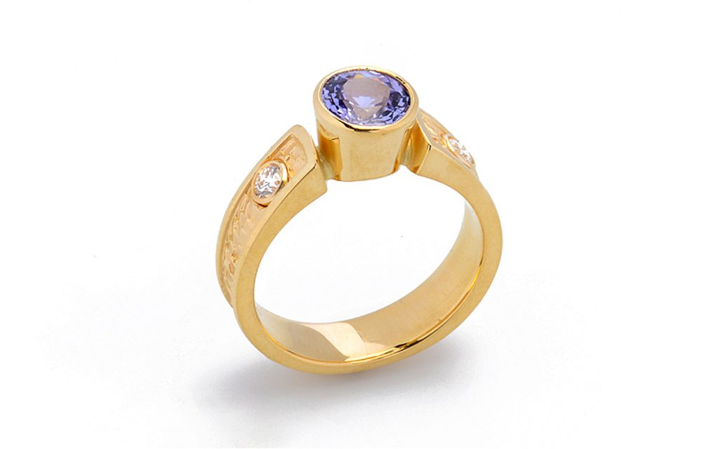 8012R - 18 karat yellow gold ring set with a 1.54ct. un-treated Color change Sapphire and .20cttw. Diamonds (8.4g) Price Upon Request