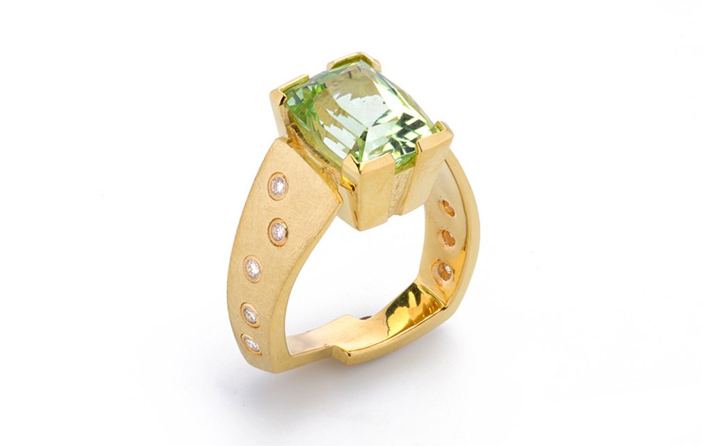 8014R - 18 karat yellow gold ring set with a beautiful 6.64ct. mint Green Tourmaline from Afghanistan. Also set with .20cttw. Diamonds (11.2g) Price Upon Request