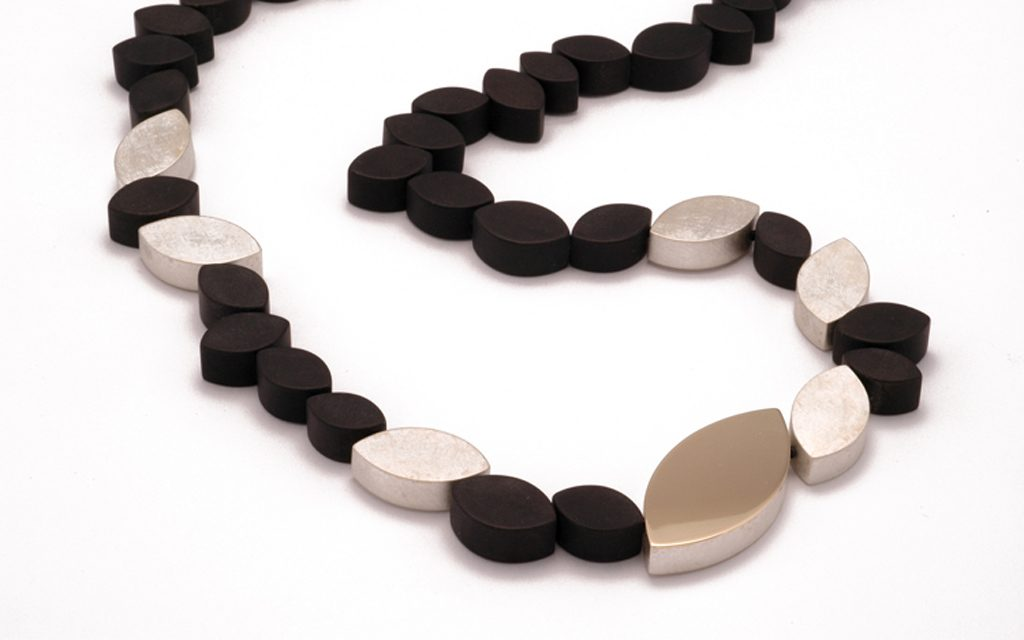 "8086N - 24"" long necklace with black Onyx, sterling Silver and 14 karat gold (3.2g) Price Upon Request"
