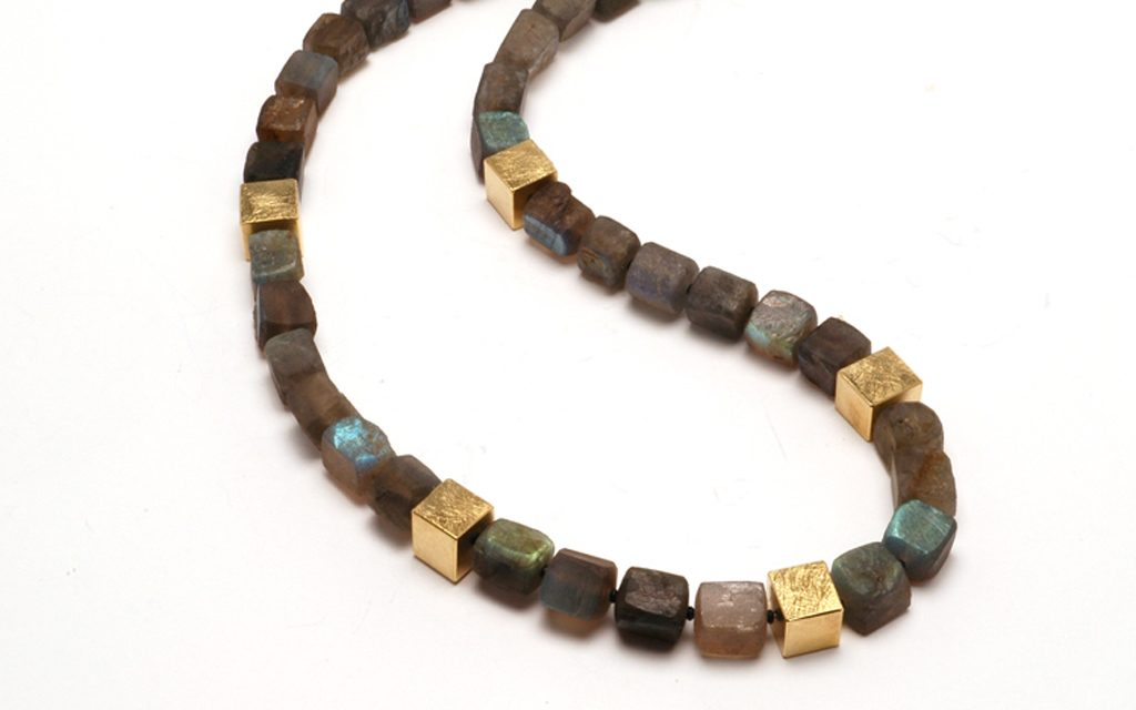 8105N - Necklace of Labradorite beads accented with 18 karat gold beads. (10.8g) Price Upon Request