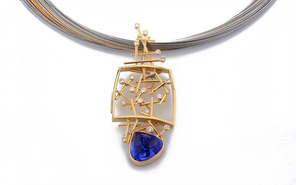 8108N - 18 karat yellow gold fabricated necklace set with a beautiful 11.87 carat Tanzanite Cabochon and .41cttw. Diamonds (14.4g) Price Upon Request